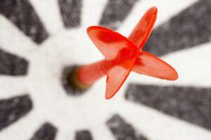 Red dart hitting the target