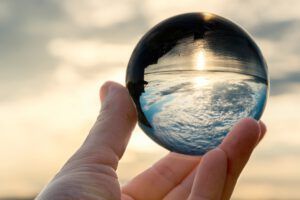 Sky in crystal ball in hand